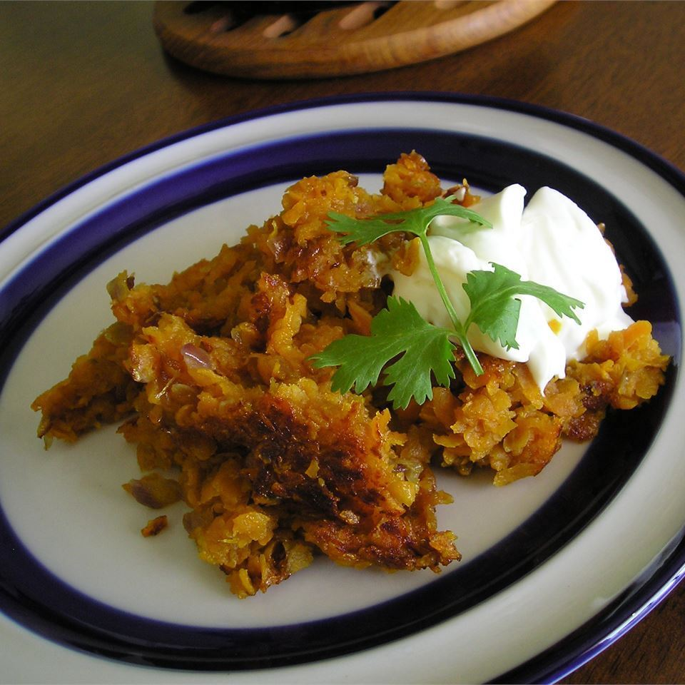 Sweet and Sassy Hash Browns on a white and blue plate