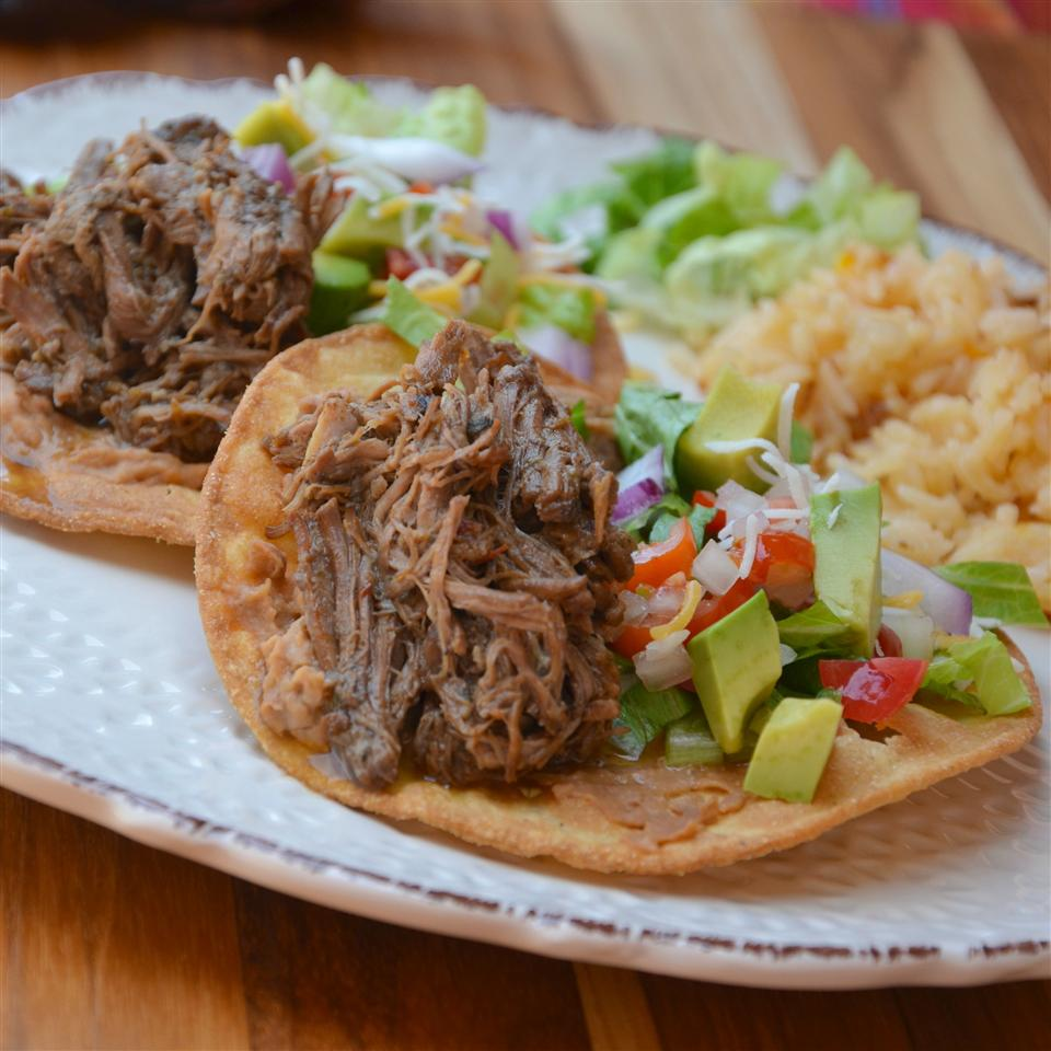 Shredded beef on tostadas with avocado and pico de gallo