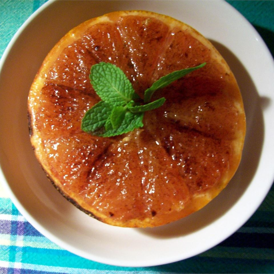 a bowl holding Broiled Grapefruit
