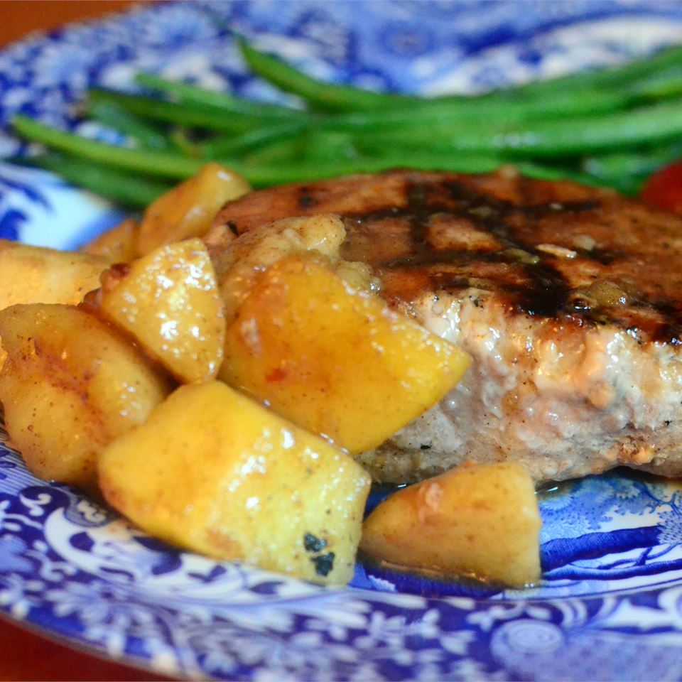 Momma Pritchett's Grilled Pork Chops and Apple-Pear Topping and green beans on a blue and white plate