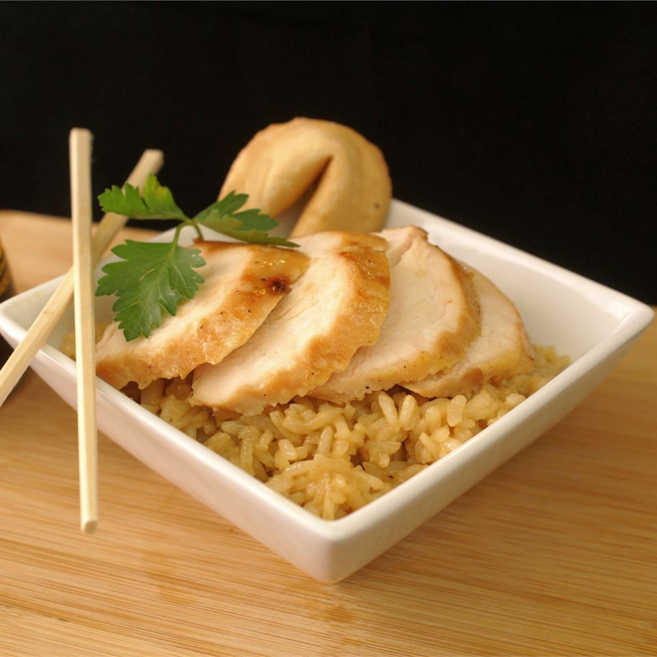 a square bowl holds rice and Teriyaki Marinated Chicken; chopsticks rest on the side