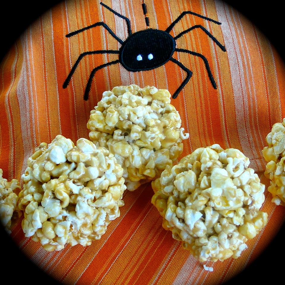 Peanut Butter Popcorn Balls on an orange and black background
