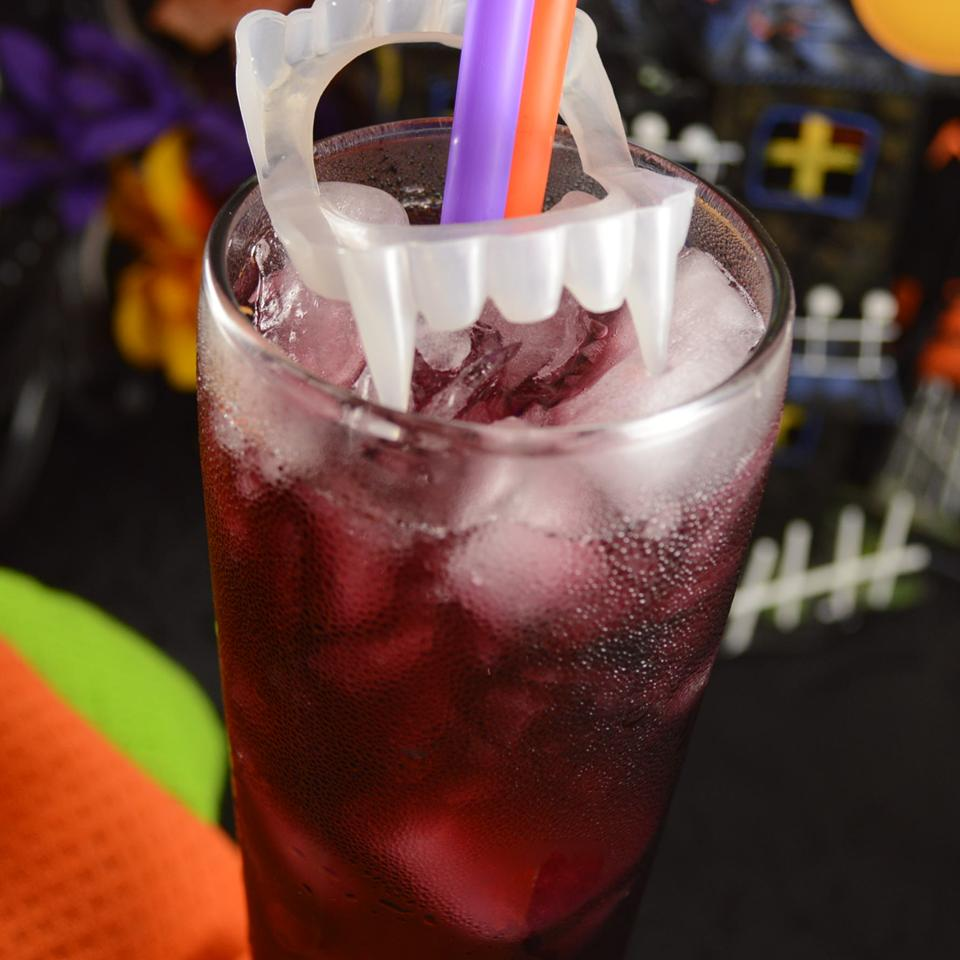 Liquid Vampire in a glass with purple and orange straws