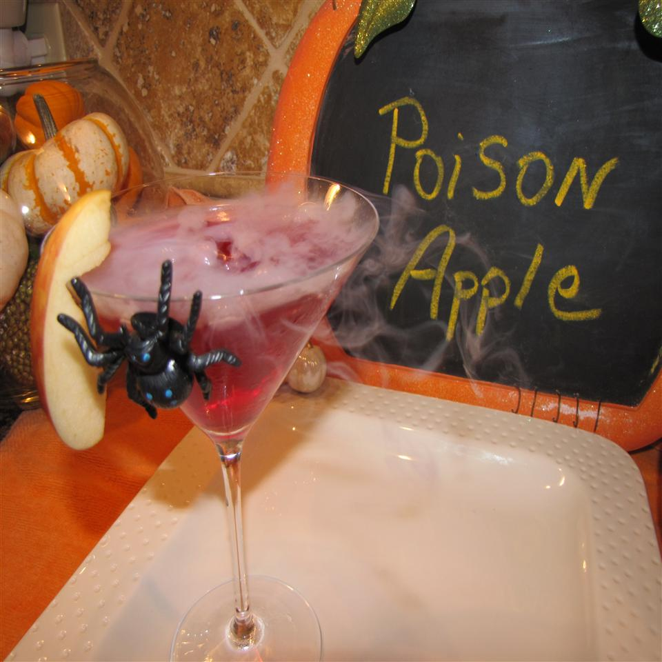 Poison Apple Martini with a slice of apple and plastic spider