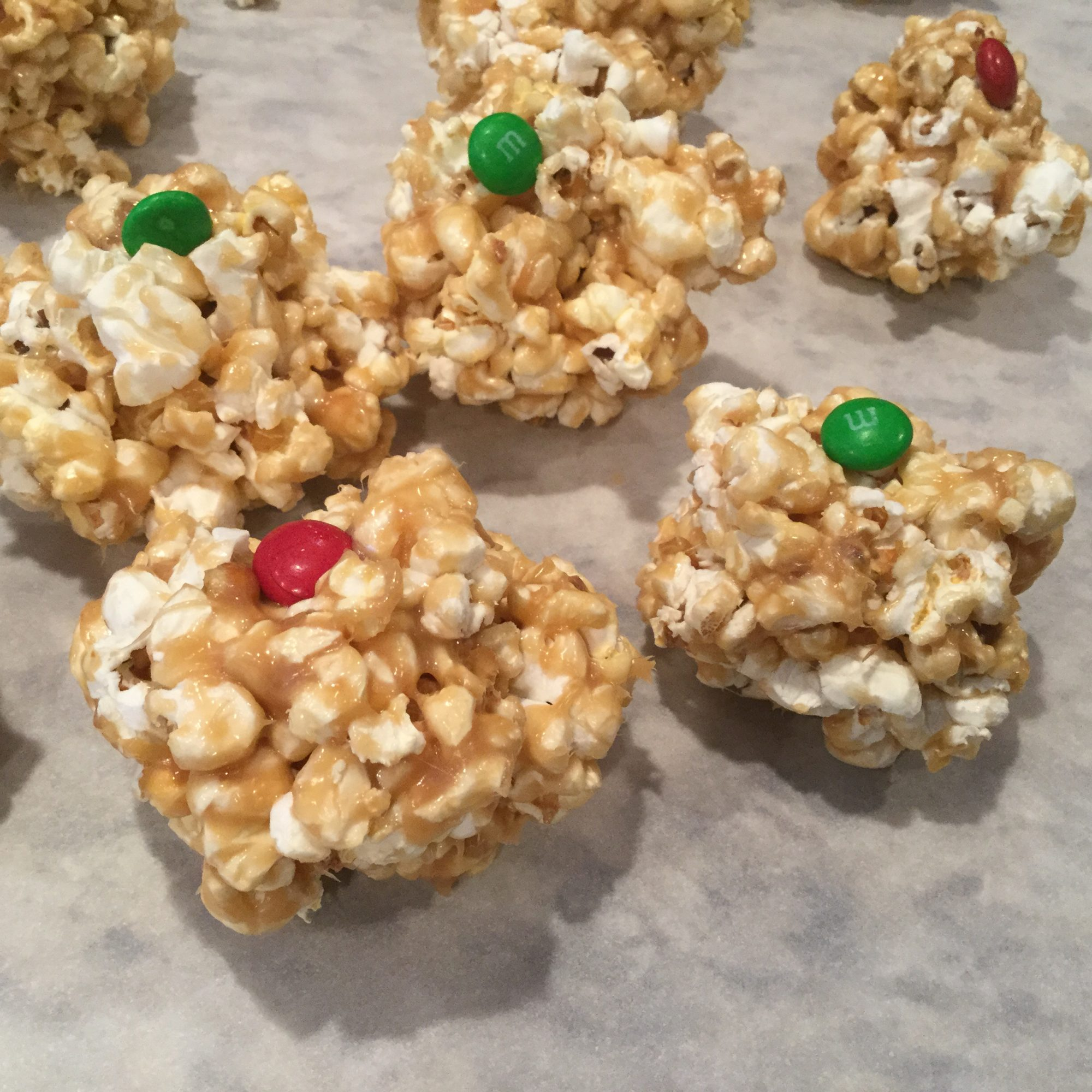 Caramel Popcorn Balls with red and green candies