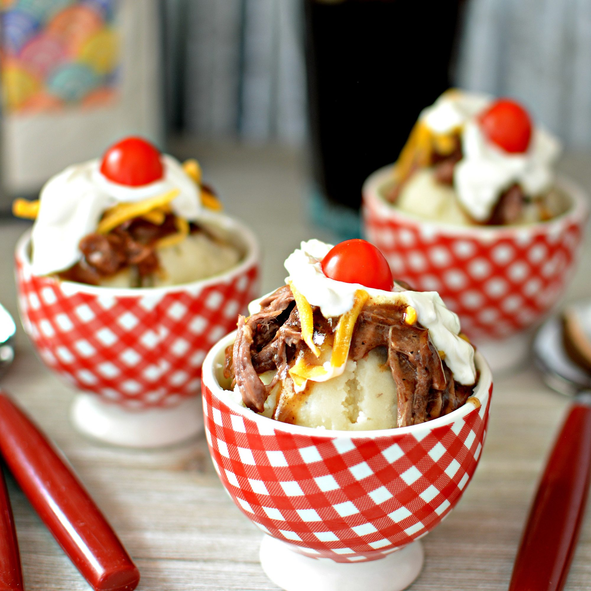 Hot Beef Sundae in red and white ice cream bowls