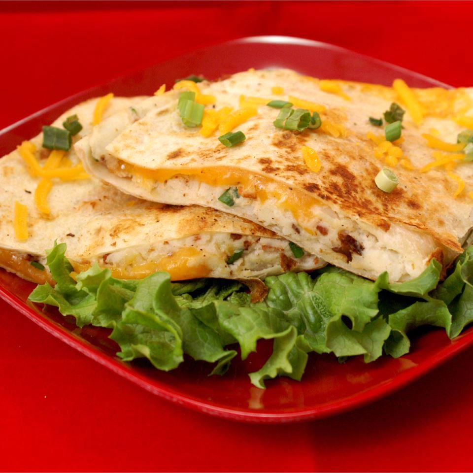 Mashed Potato Quesadilla on a red plate with lettuce garnish