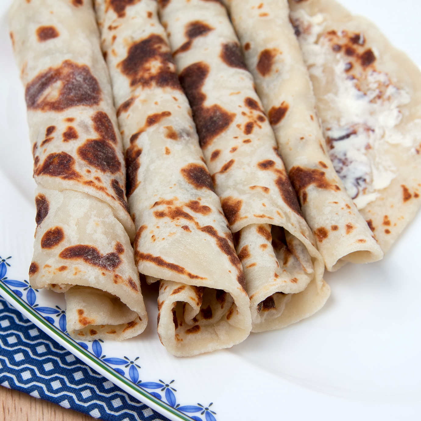 Several pieces of rolled lefse on a plate