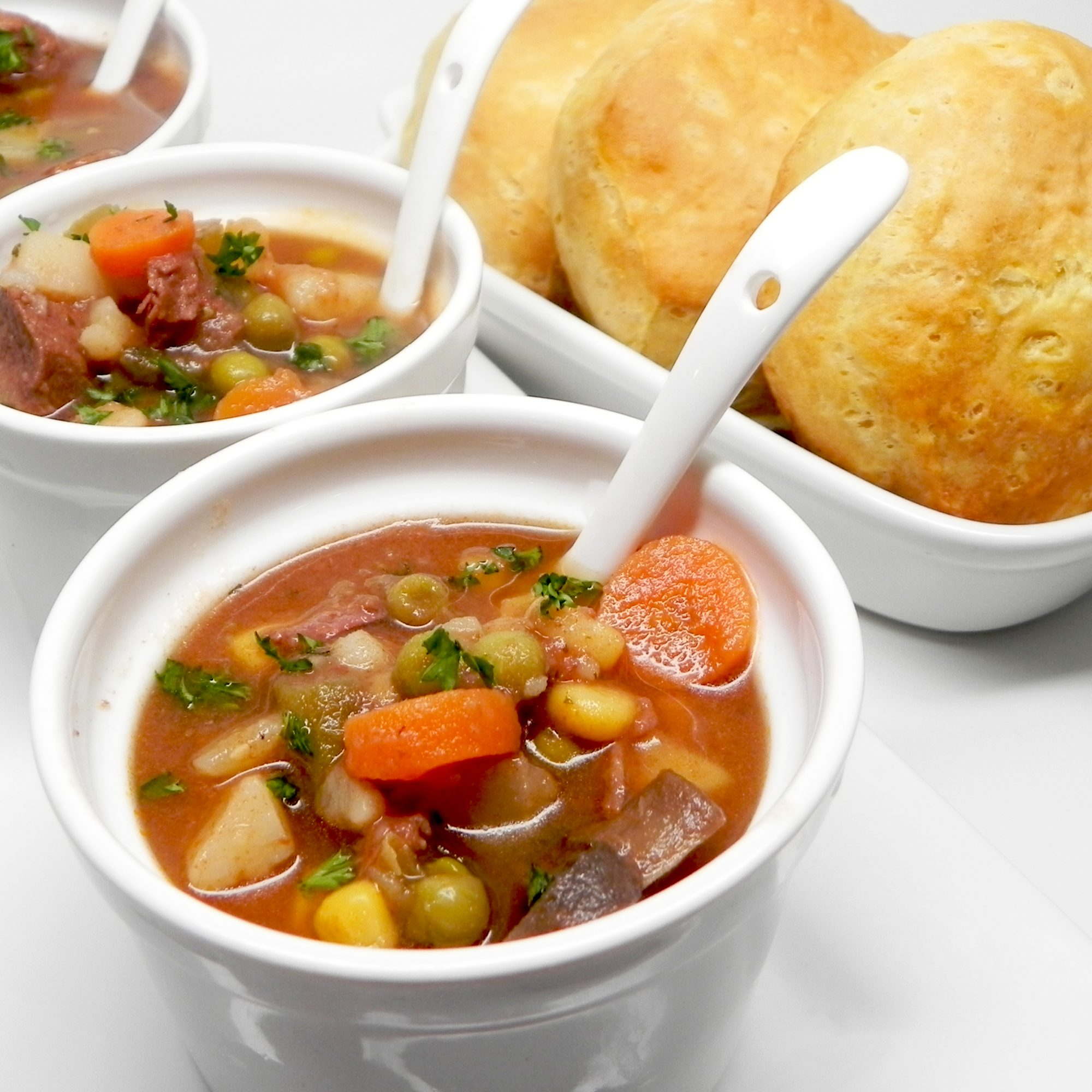 Prime Rib Stew in mini bowls with side of biscuits