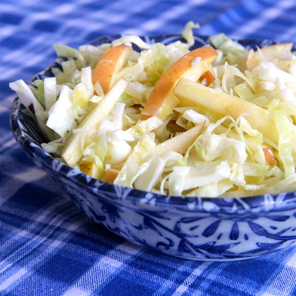 Easy Apple Cabbage Slaw in a blue bowl on a blue and white gingham tablecloth