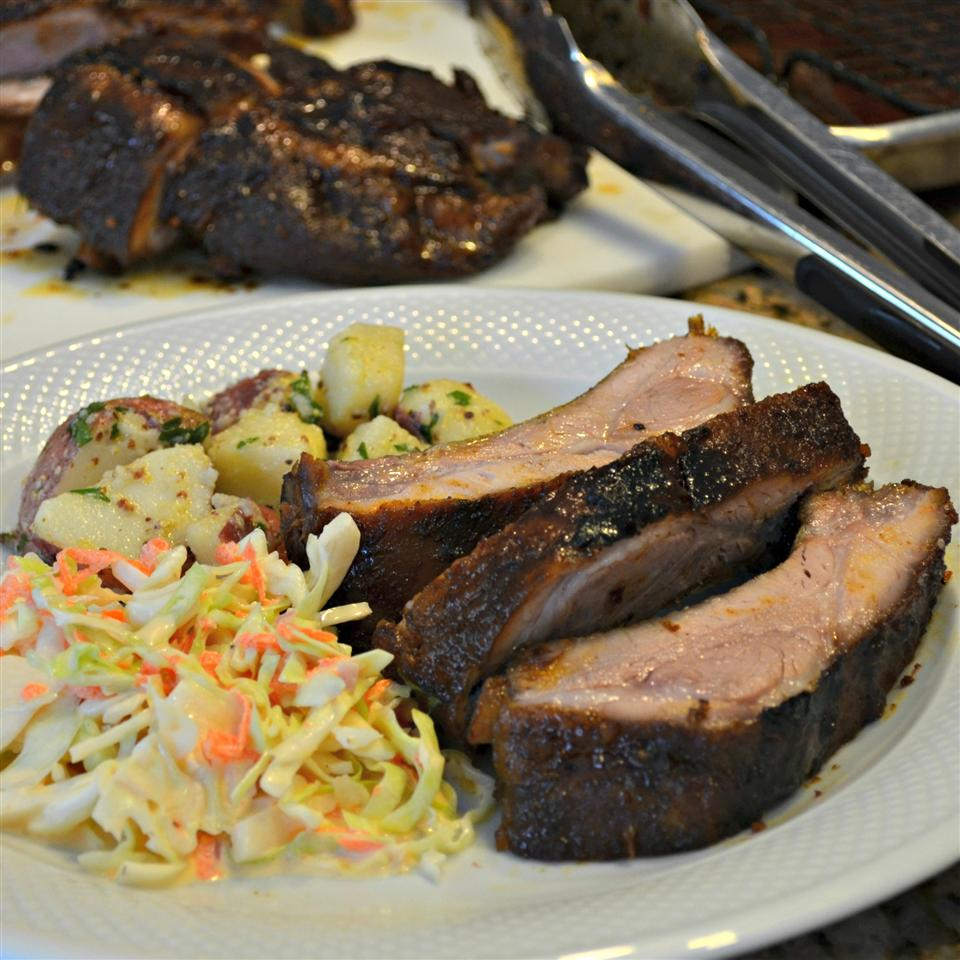 Sweet Spicy Asian Style BBQ Back Ribs on a plate with slaw