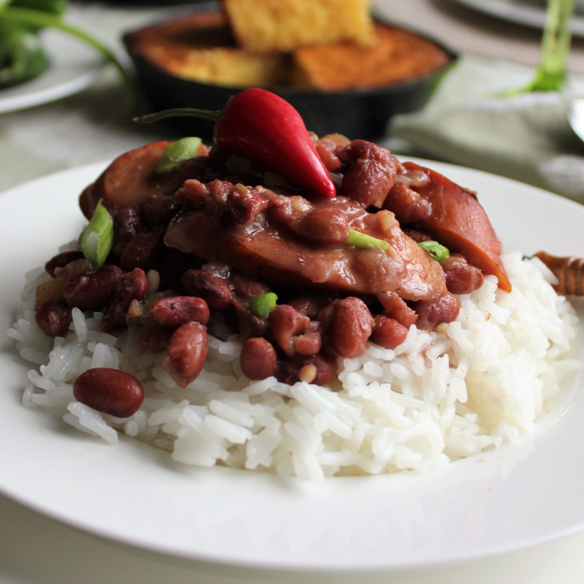 Authentic Louisiana Red Beans and Rice on a white plate