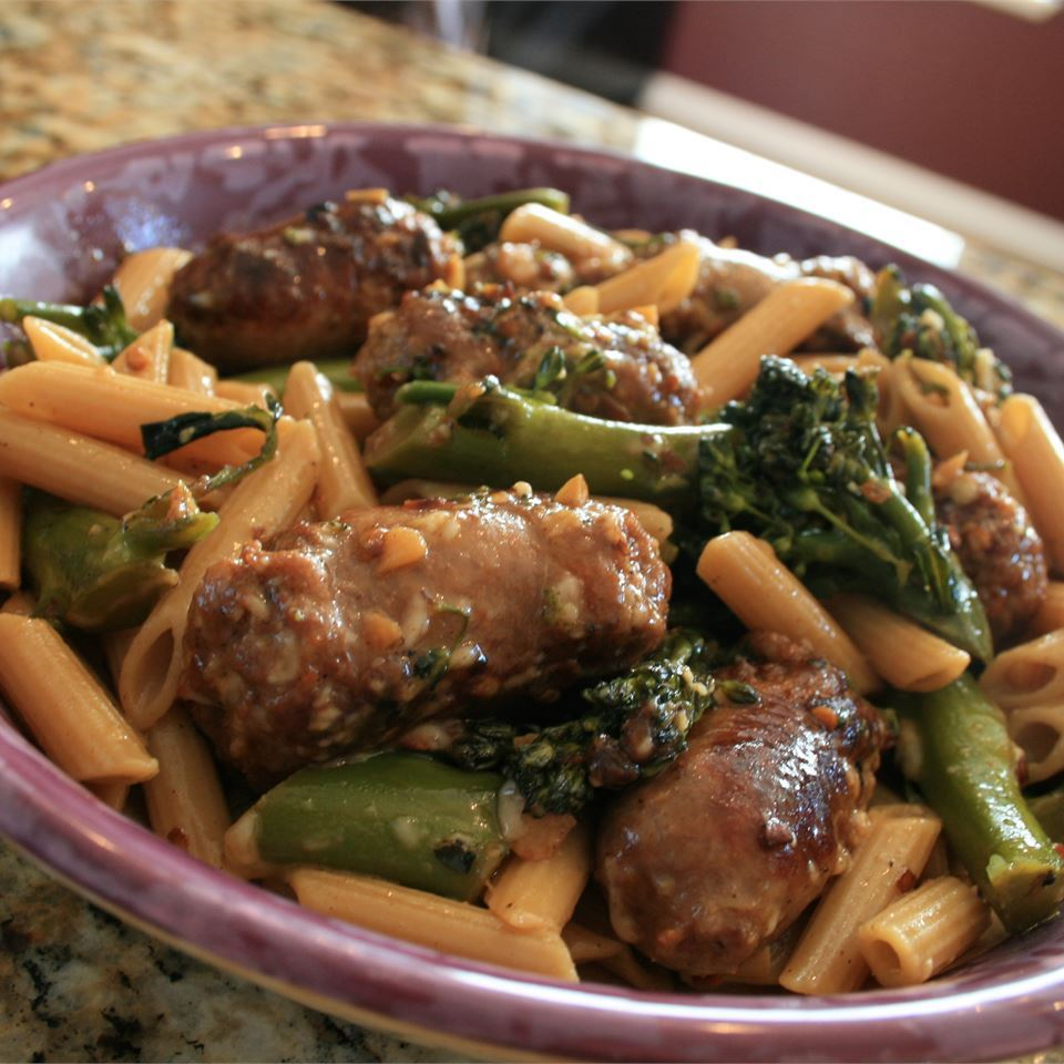 Penne with Sausage and Broccoli Rabe in a purple bowl
