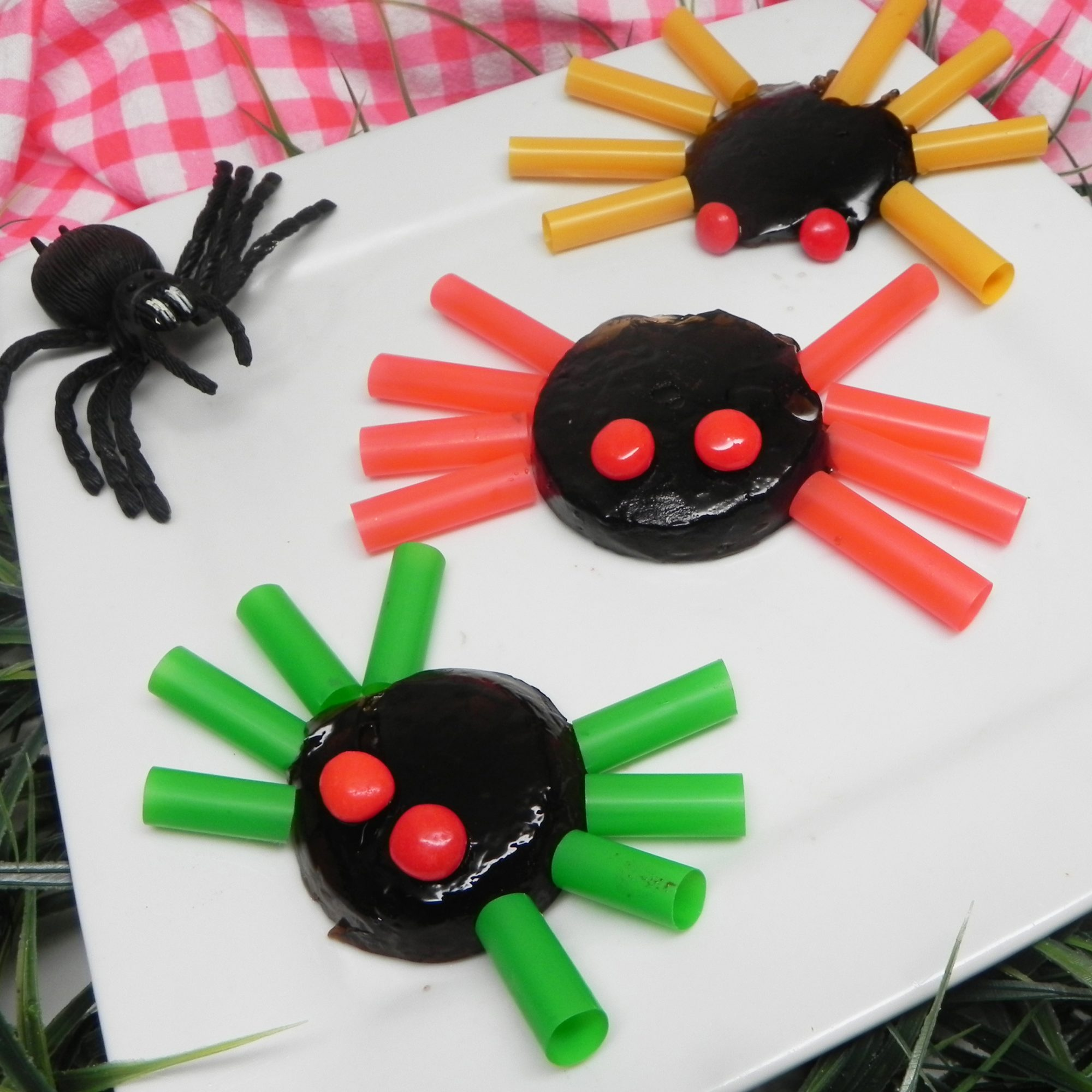 Gelatin spiders with colorful legs