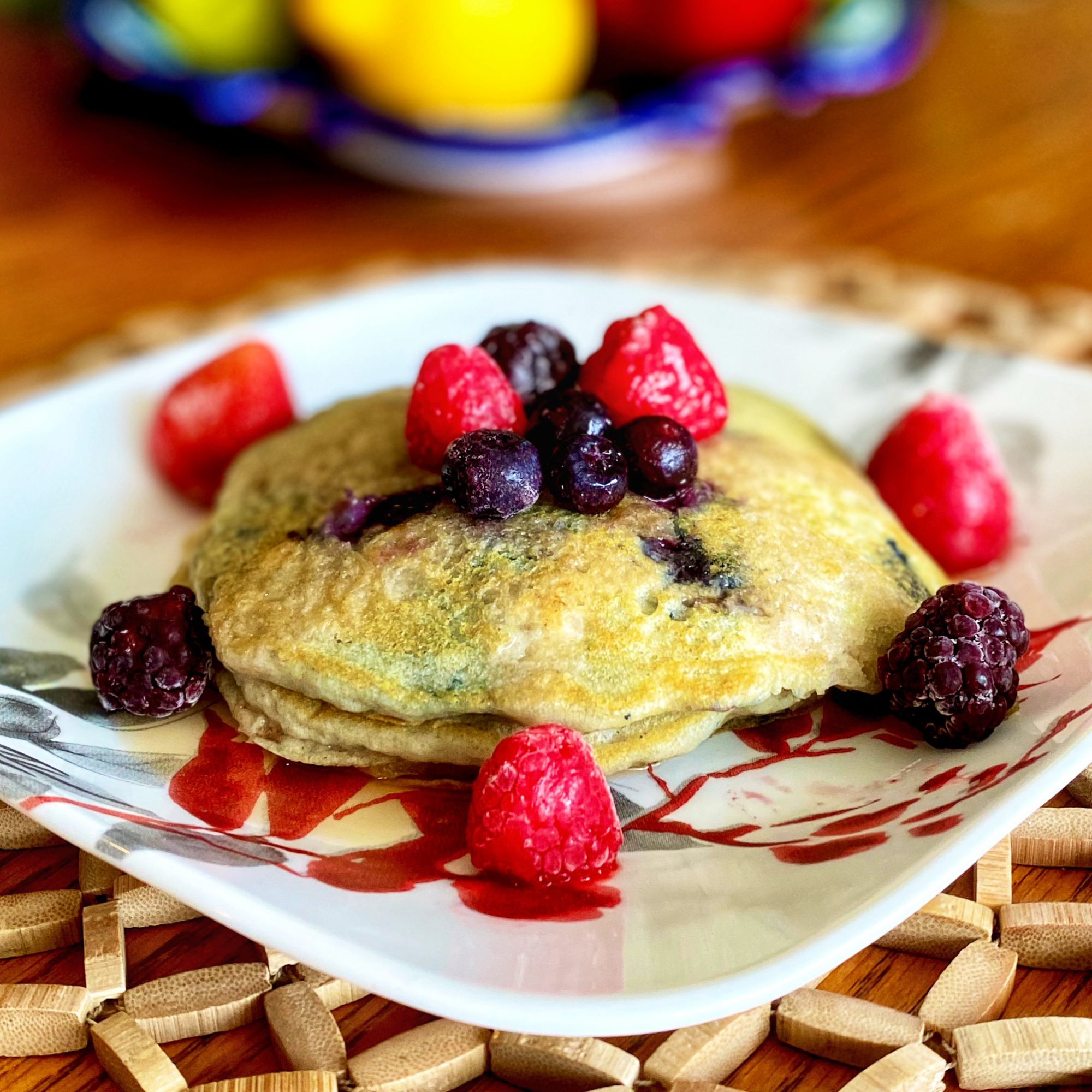 Vegan Blueberry Pancakes surrounded by berries