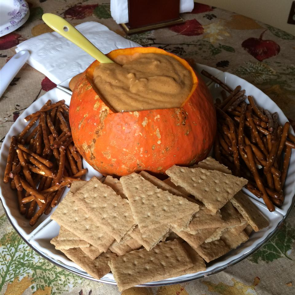 Pumpkin Dip in a hollowed out pumpkin with graham crackers