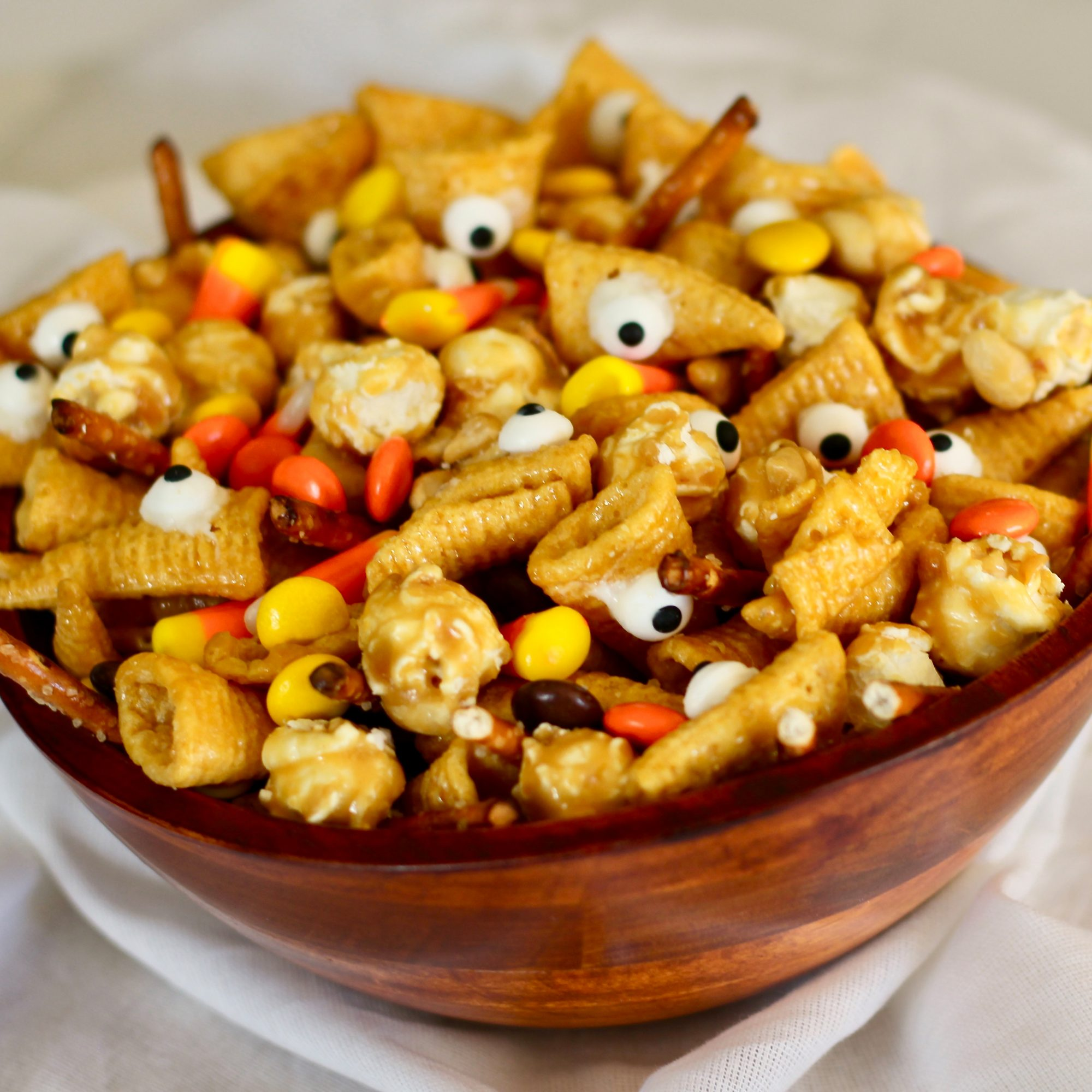 snack mix in a wooden bowl