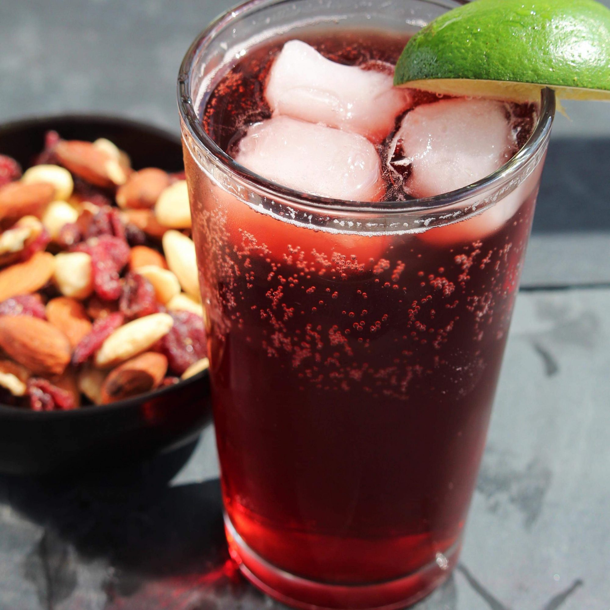 Sparkling Hibiscus Cooler with a grey background