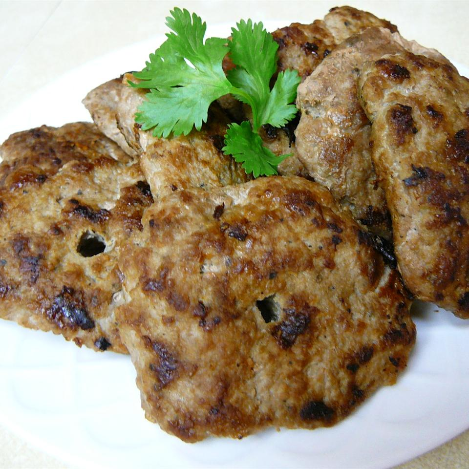 Turkey Sausage Patties on white plate with green parsley