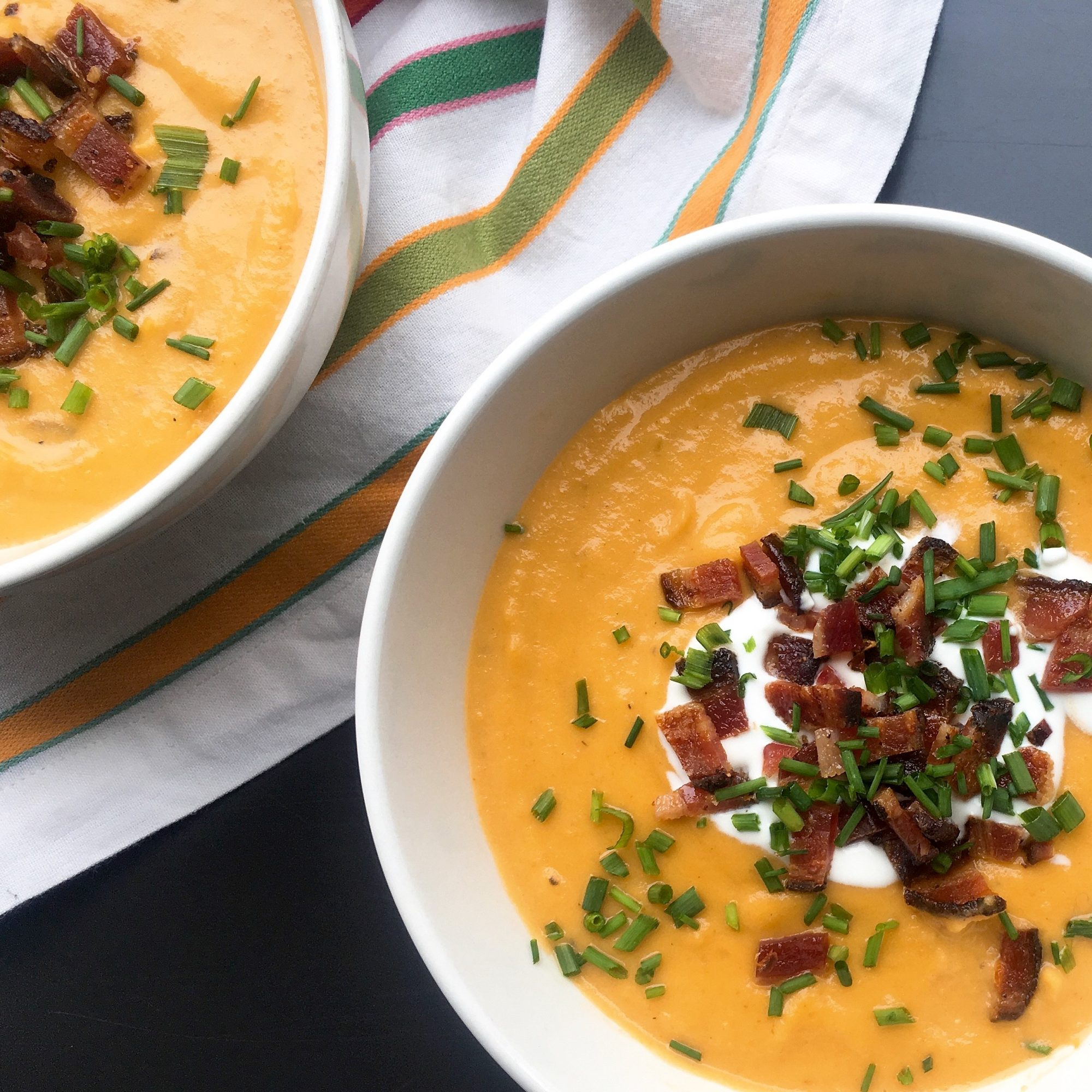 two bowls of Potato-Parsnip Soup with Creme Fraiche and Bacon