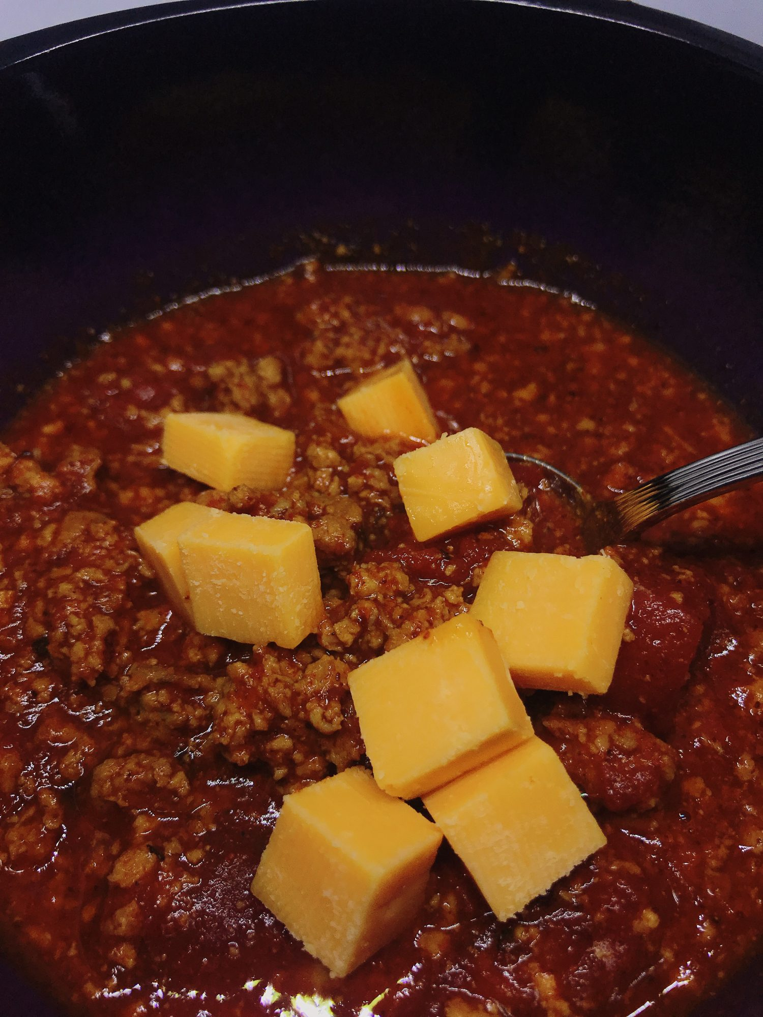 Instant Pot turkey Chili with cubes of cheese o ntop