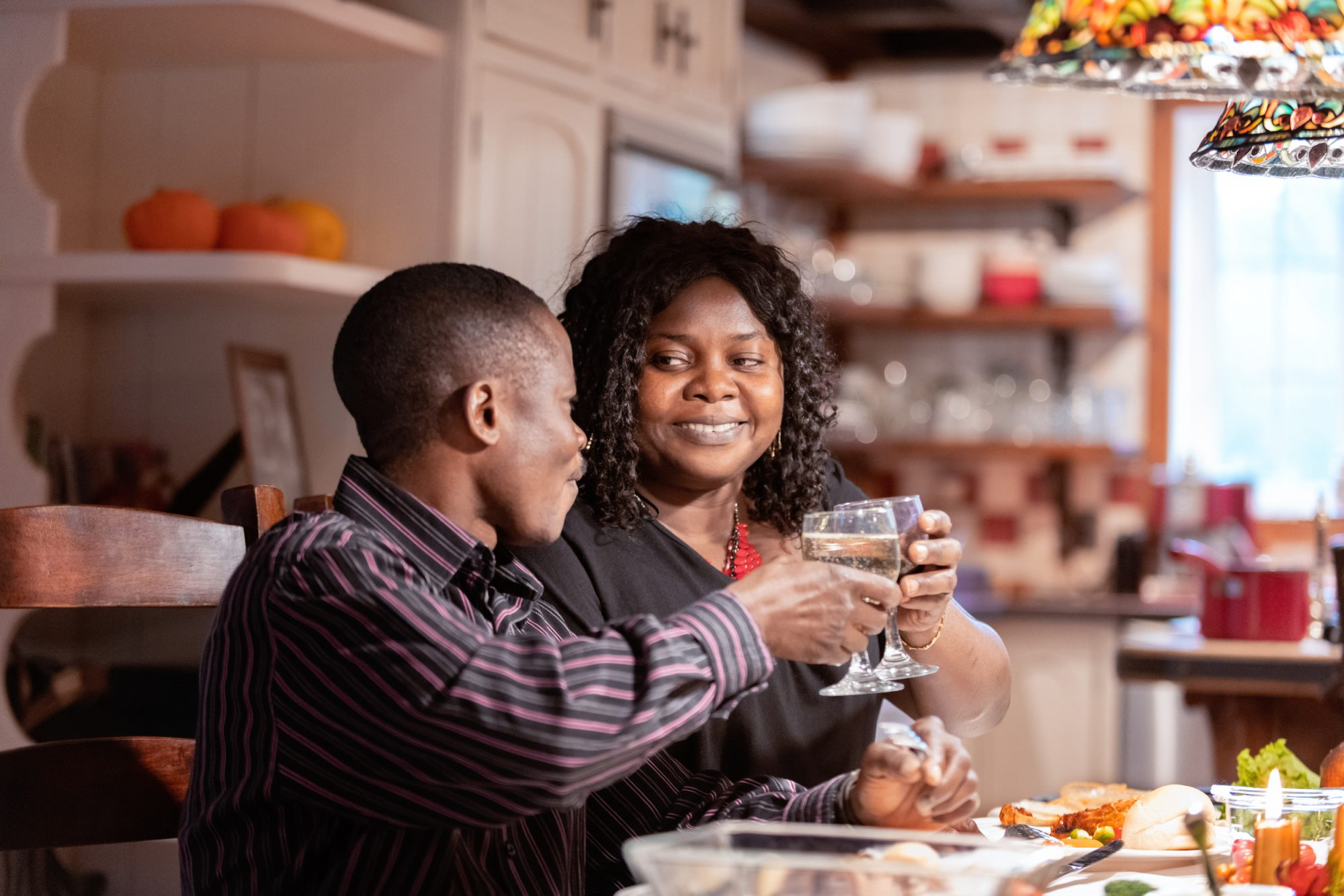 couple at table during Thanksgiving dinner