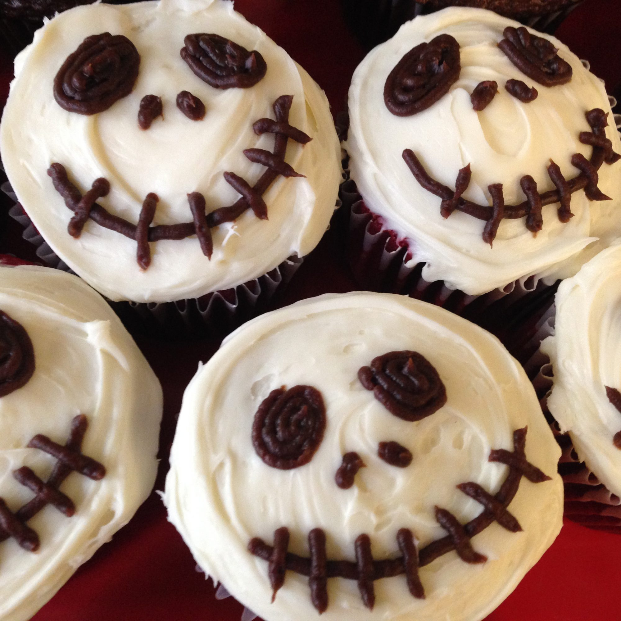 Creepy Halloween Skull Cupcakes on a red background