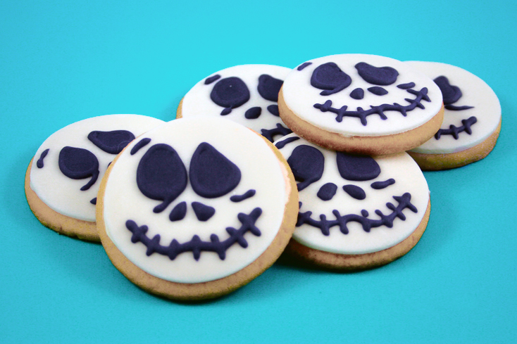 Round cookies decorated for Halloween to look like Jack Skellington faces