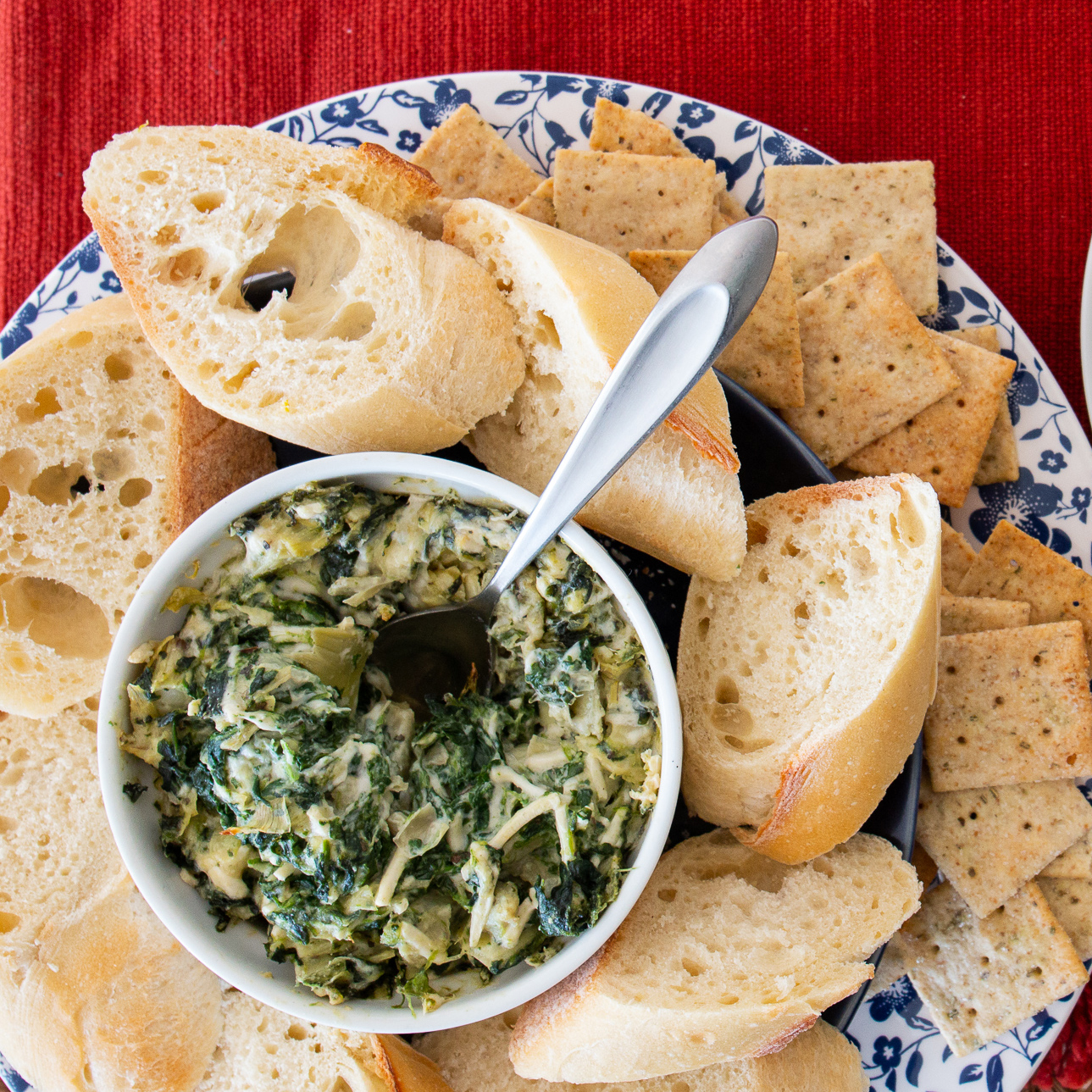 Vegan Hot Artichoke and Spinach Dip with bread and crackers