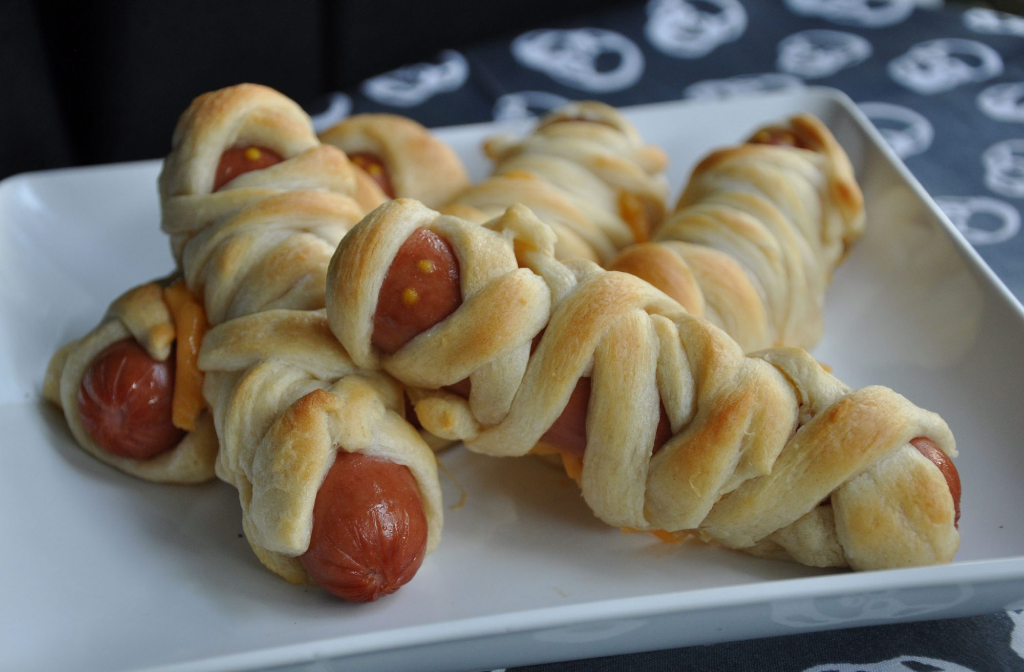 Hot dogs wrapped in crescent roll dough to look like mummies