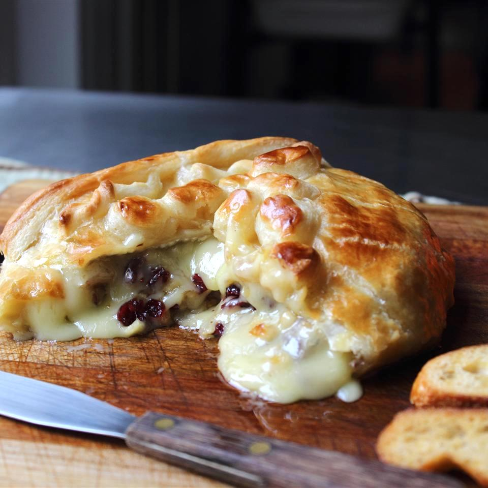 cranberry brie pastry appetizer on a cheese board