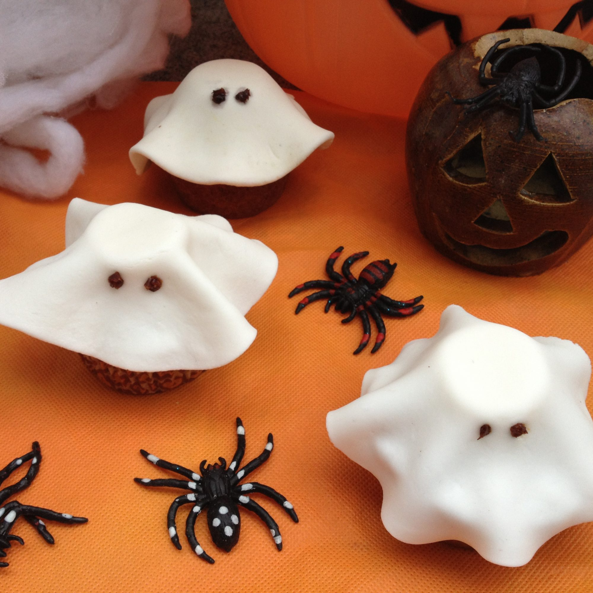 Halloween Fondant Ghost Cupcakes on an orange background
