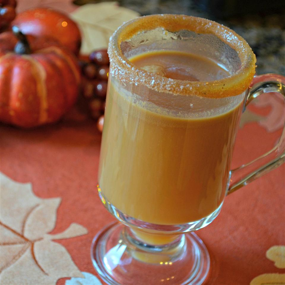 Caramel Apple Cider with Salty-Sweet Rim on an orange background