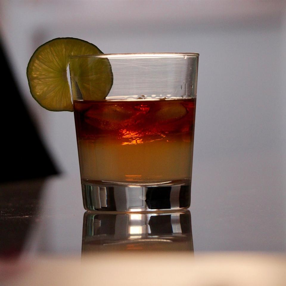 Dark 'n' Stormy Ginger cocktail with a slice of lime