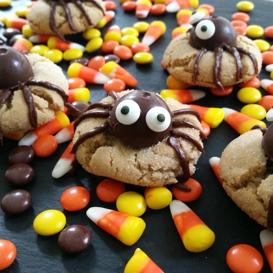 spider design on cookies surrounded by candy corn