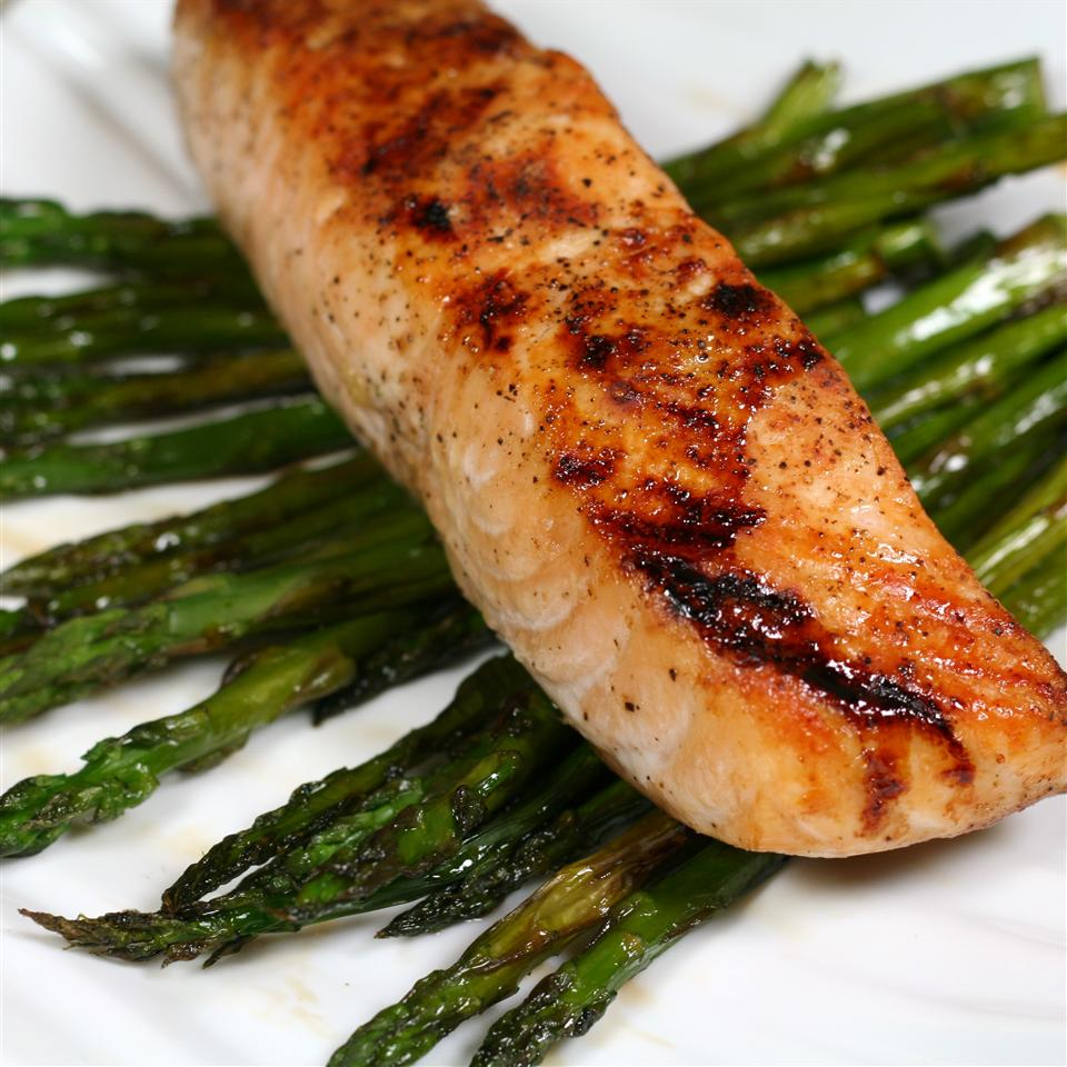Soy-Honey Glazed Salmon with Asparagus on a white background