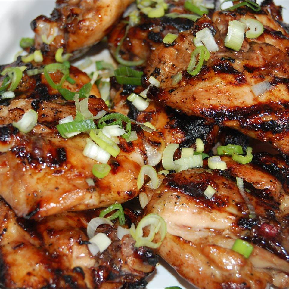 Asian Glazed Chicken Thighs topped with green onions