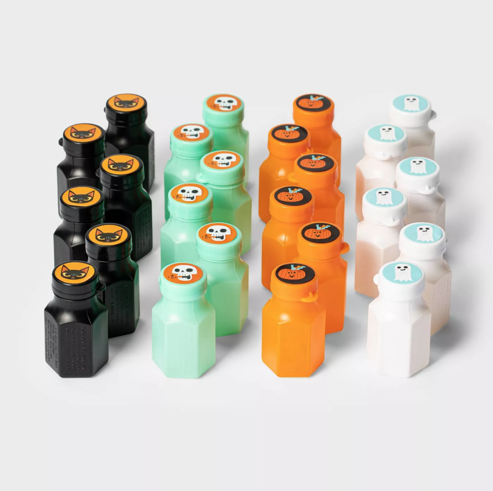 black, green, orange, and white containers of bubbles
