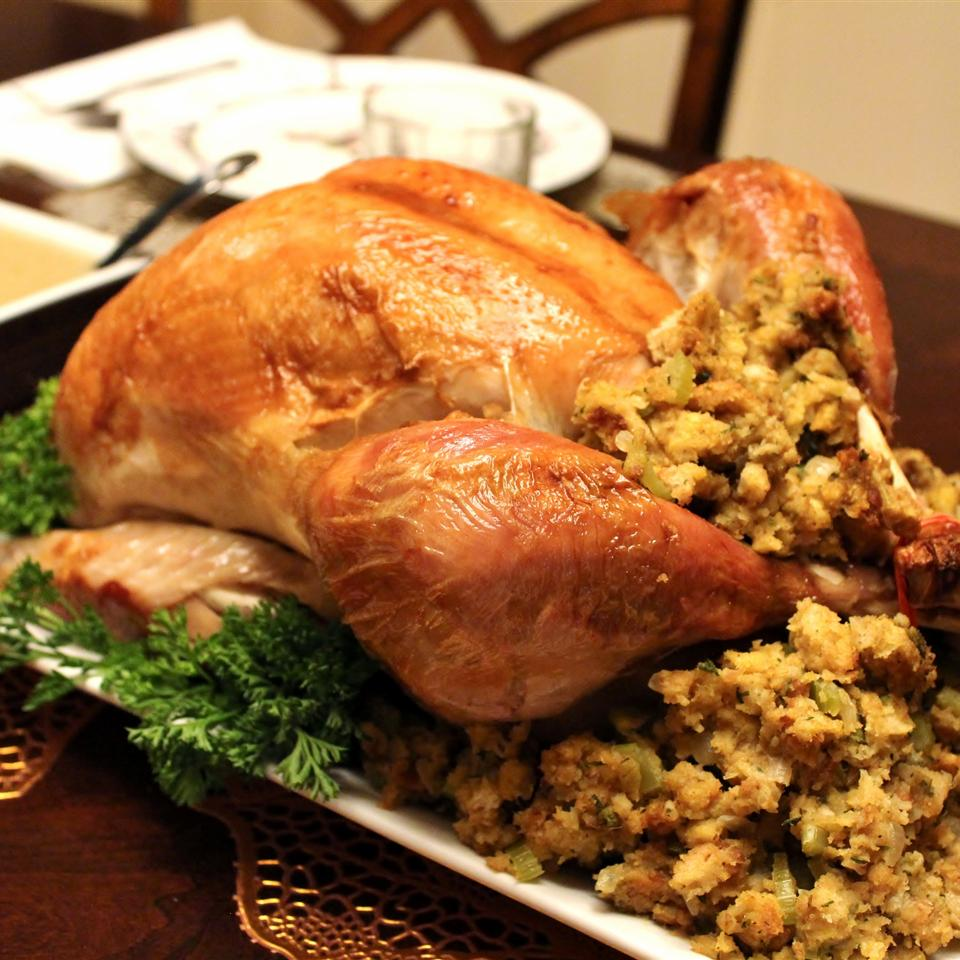 brined and roasted whole turkey on a platter with stuffing