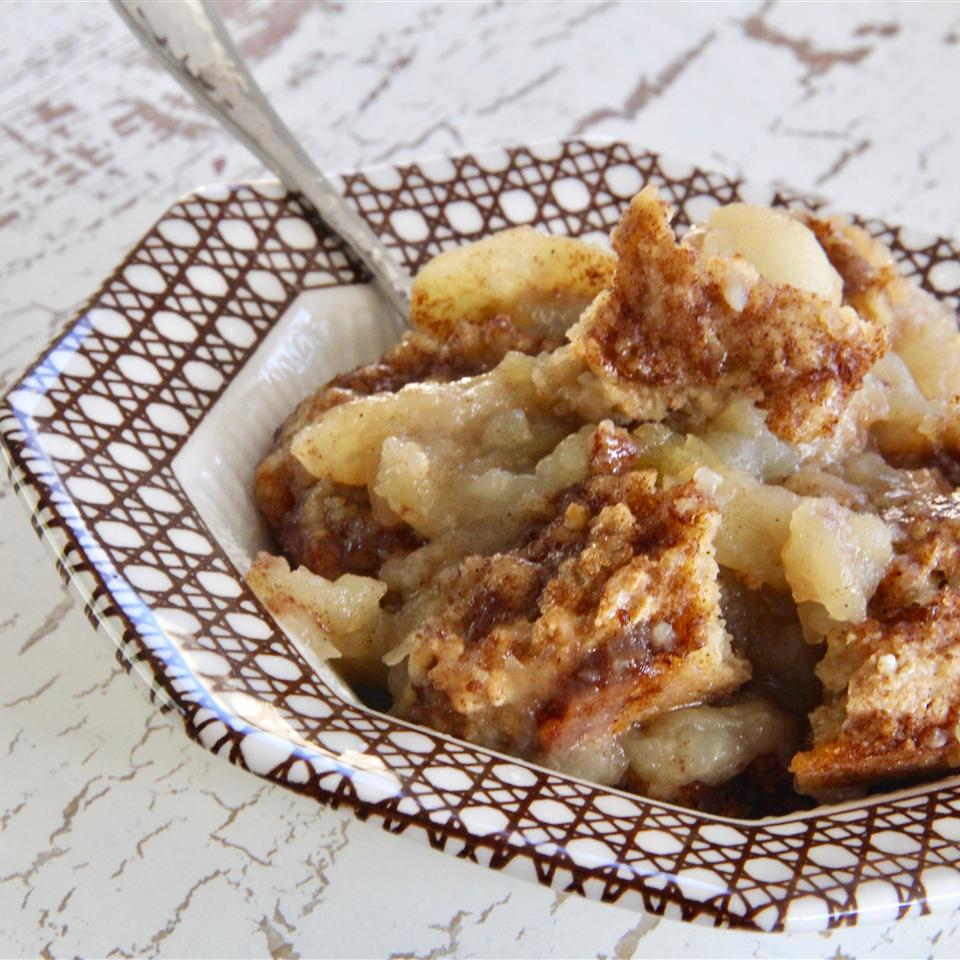 Apple cobbler in brown and white bowl
