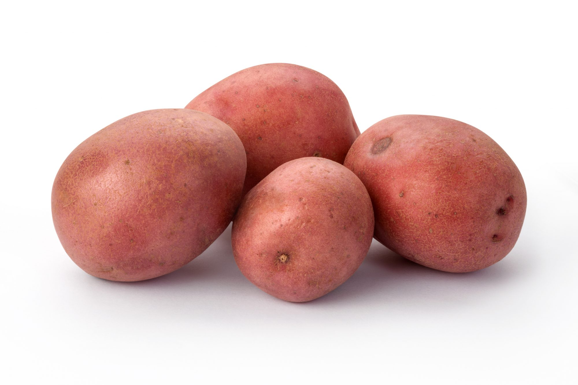 Four Fresh Red Potatoes in a Group isolated