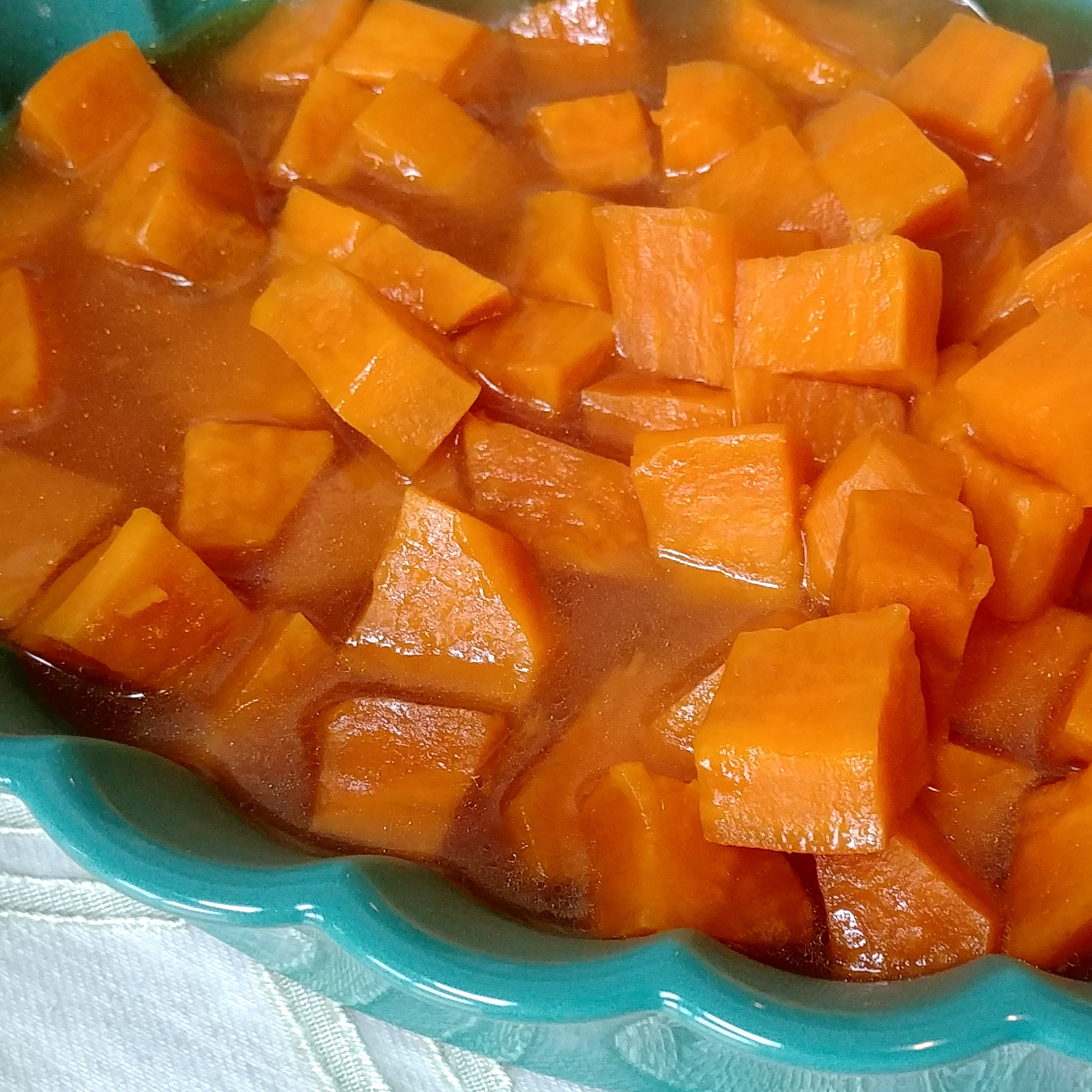 candied sweet potatoes in turquoise bowl