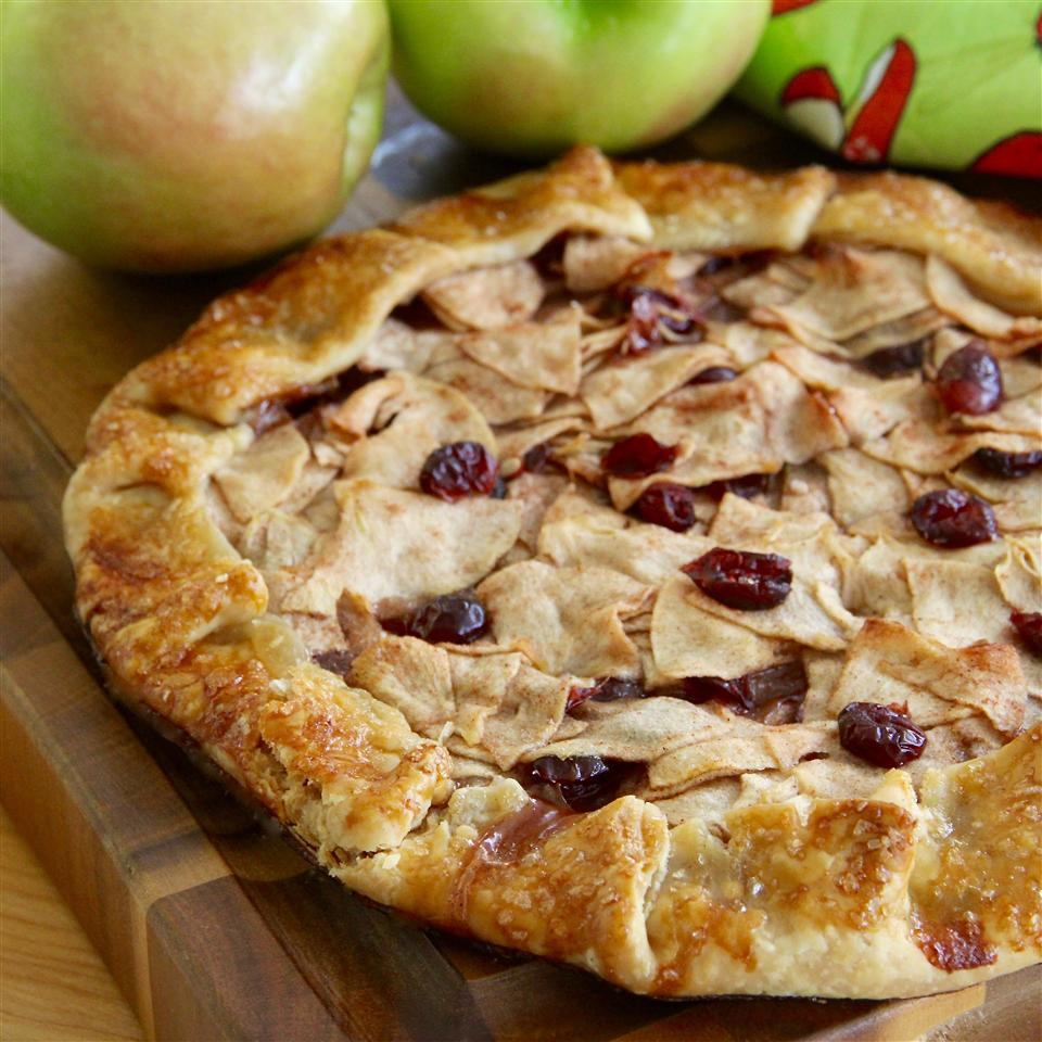 apples and cranberries in an open-face pastry shell