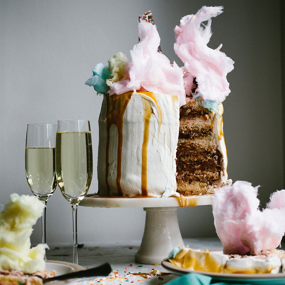 multi-layered funfetti ice cream decorated with cotton candy flaircake with