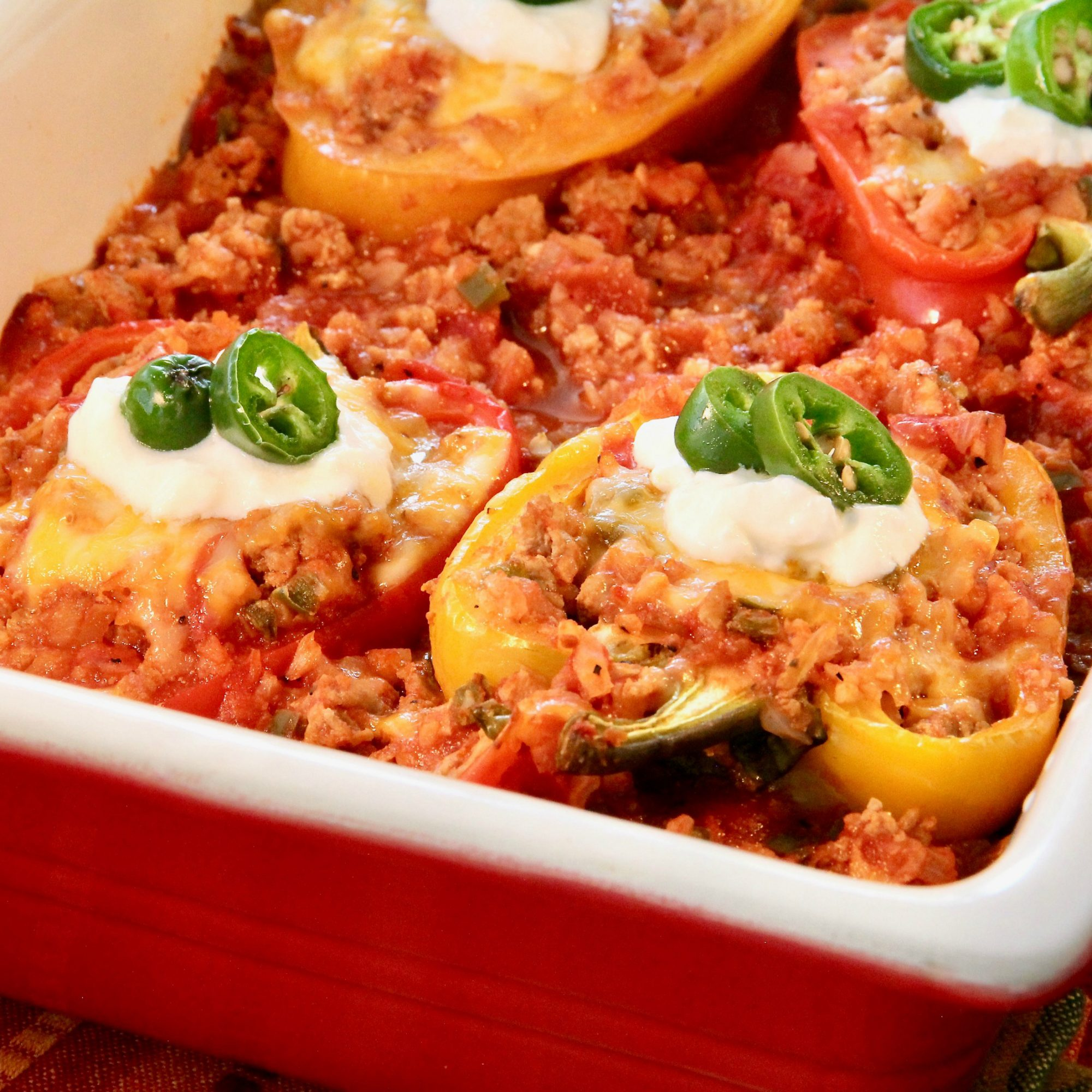 Low Carb Turkey-Stuffed Peppers in a red dish