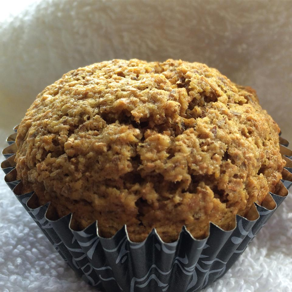 Apple and carrot muffin in a muffin tin