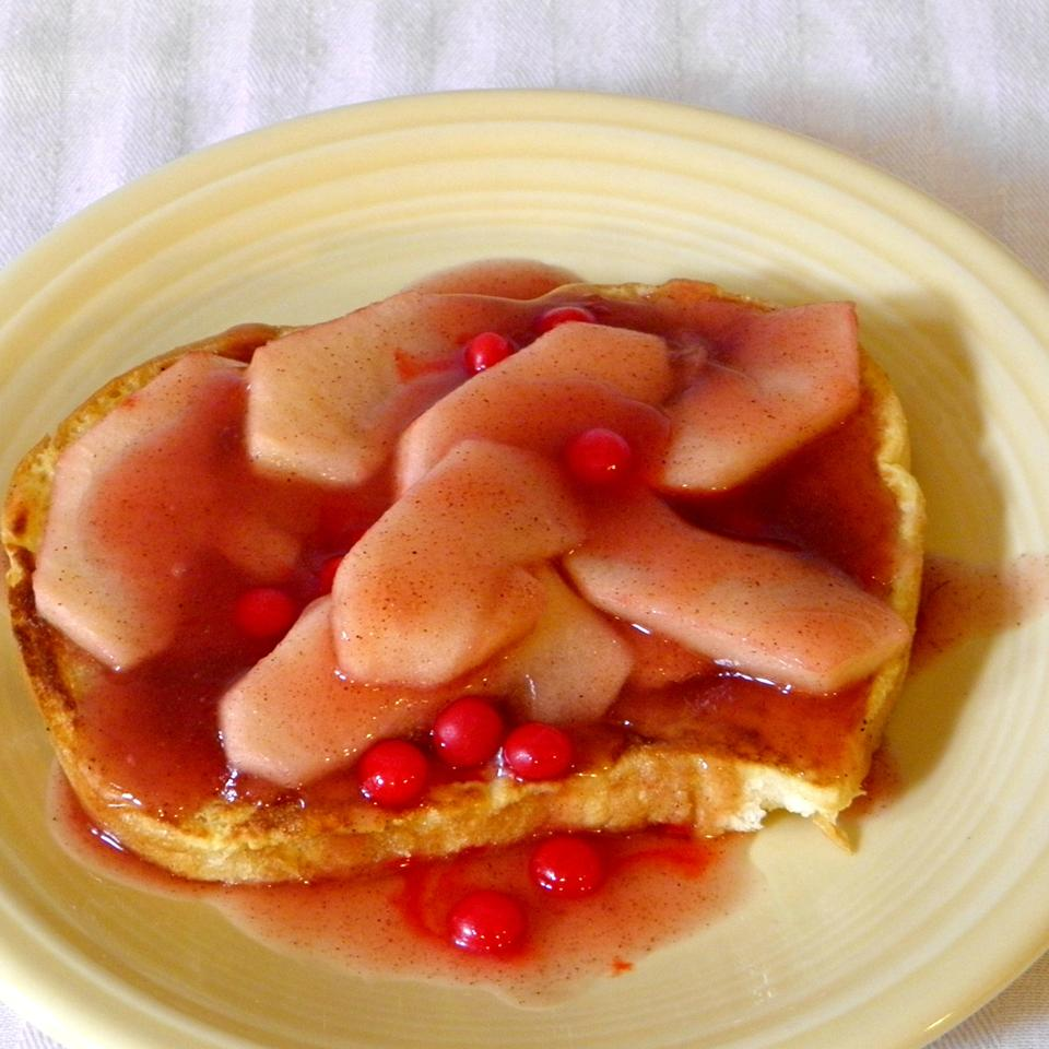 Toast with syrup and cinnamon apples on top