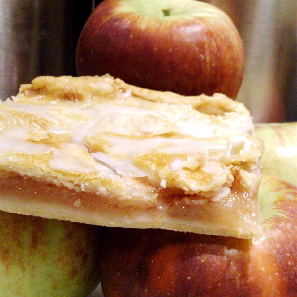 Danish Pastry Apple Bars with apples in the background