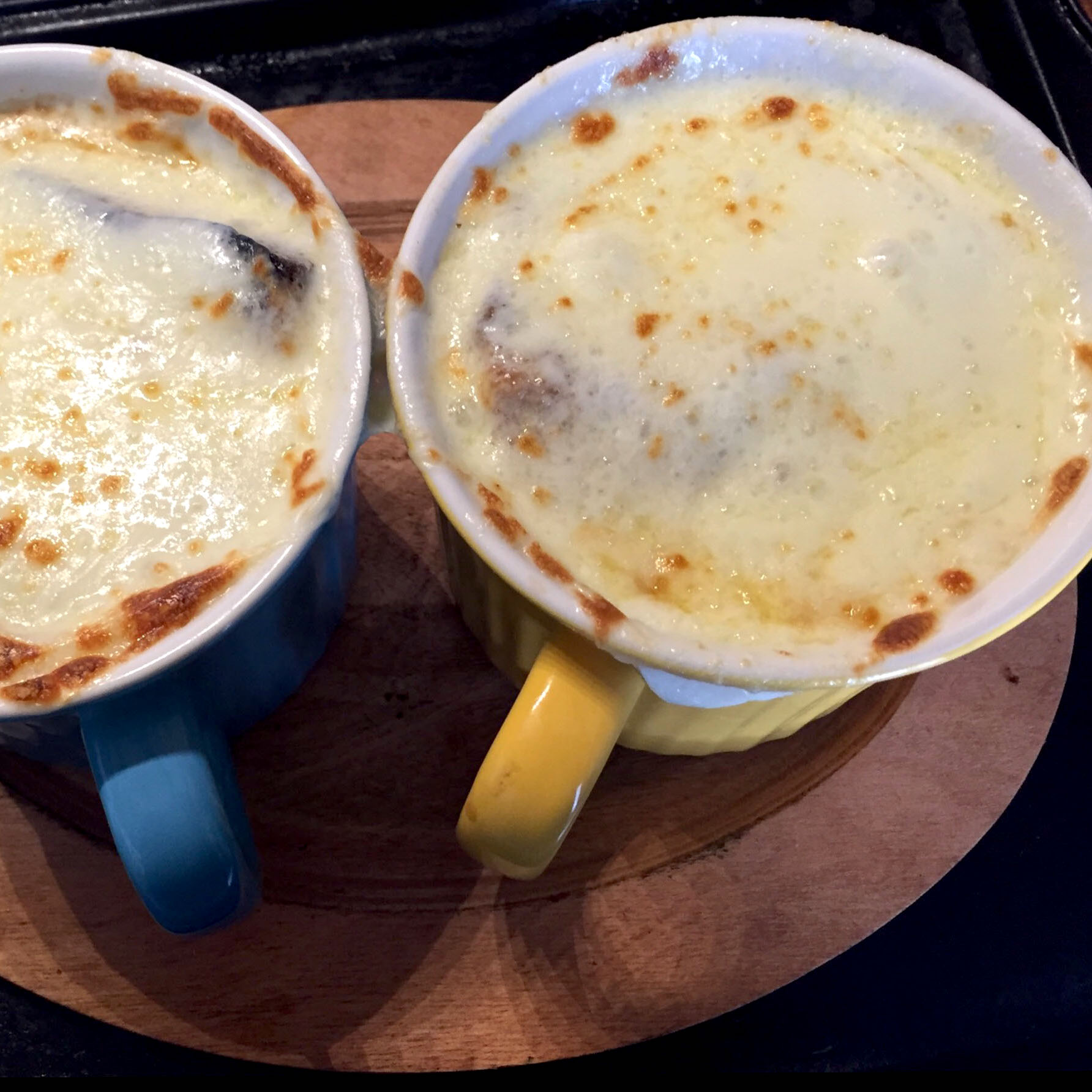 two cups of French Onion Soup With Browned Garlic