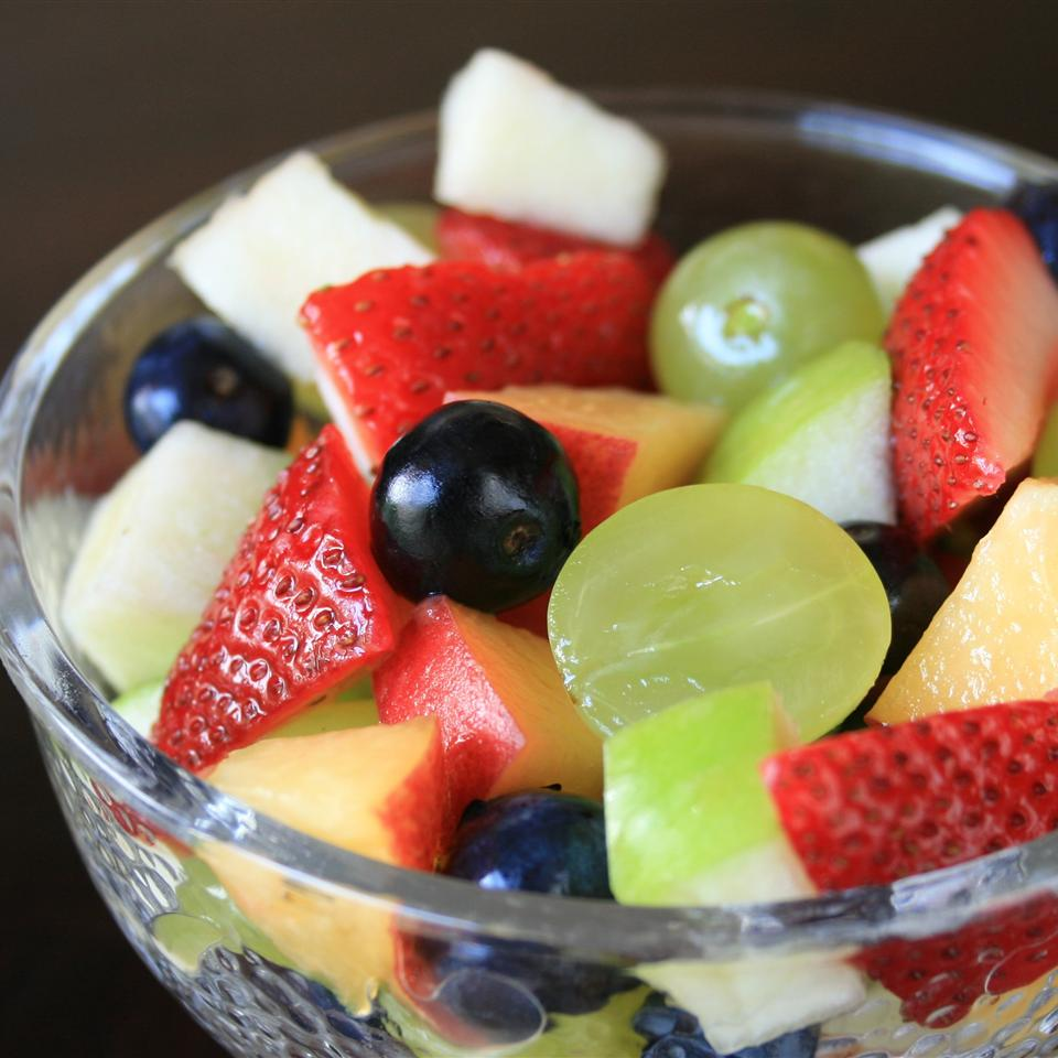 Fruit salad with strawberries, apples, grapes, and blueberries